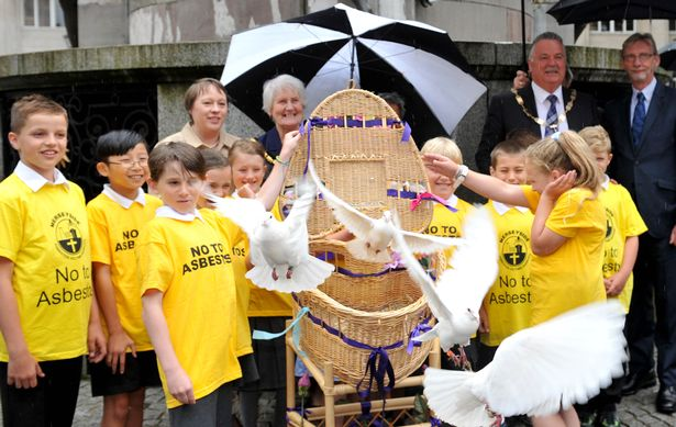 Pupils from New Brighton Primary School along with dignitaries and Merseyside Asbestos Group released doves in Exchange Flags Liverpool in memory of all the people who have died the past year from asbestos exposure.